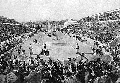 Spyridon Louis entering the Panathenaic Stadium at the end of the marathon; 1896 Summer Olympics. Louis entering Kallimarmaron at the 1896 Athens Olympics.jpg