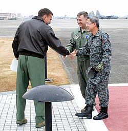 Lt. Gen. Ted Kresget, 13th Air Force Commander, greets Japan Air Self-Defense Force Lt. Gen. Haruhiko Kataoka, Air Defense Command Commander at Yokota AB.jpg