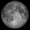Lunar libration with phase Oct 2007 frame.png