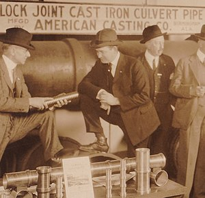 Maxey Dell Moody - Maxey, center, at American Cast Iron Pipe Company in Birmingham, Alabama around 1921.