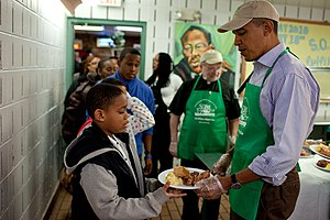 Martin Luther King Jr. Day - In honor of the Martin Luther King Day of Service, President Barack Obama serves lunch in the dining room at So Others Might Eat, a soup kitchen in Washington, January 18, 2010.
