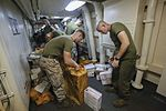 Mail call, U.S. Marines and Sailors sort packages 150815-M-TJ275-123.jpg