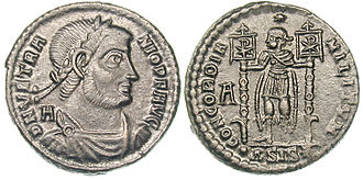 Labarum - Coin of Vetranio, a soldier is holding two labara. Interestingly they differ from the labarum of Constantine in having the Chi-Rho depicted on the cloth rather than above it, and in having their staves decorated with phalerae as were earlier Roman military unit standards.