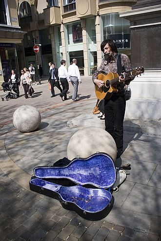 Culture of Manchester - A busker in St Ann's Square