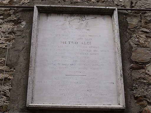 Sign on the house of birth of Pietro Aldi in Manciano