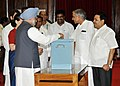 Manmohan Singh casting his vote in the Vice Presidential election at Parliament House, in New Delhi. The Union Minister for Parliamentary Affairs and Water Resources, Shri Pawan Kumar Bansal.jpg