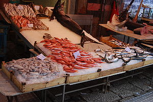 Market in Palermo, this stand is selling fish.