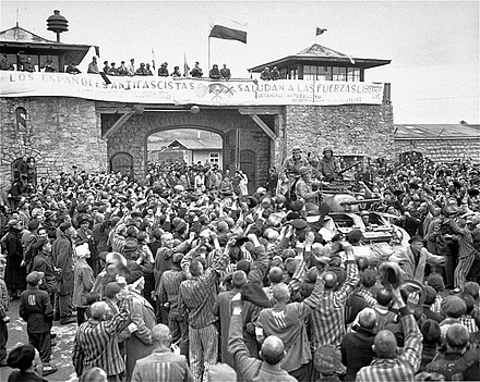 Tanks of U.S. 11th Armored Division entering the Mauthausen concentration camp; banner in Spanish reads &quotAntifascist Spaniards greet the forces of liberation&quot. The photo was taken on 6 May 1945 - Mauthausen-Gusen concentration camp