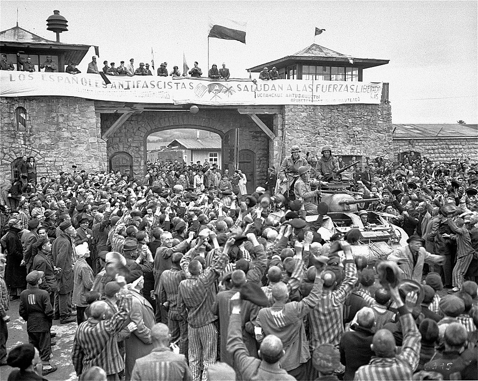 Mauthausen survivors cheer the soldiers of the Eleventh Armored Division
