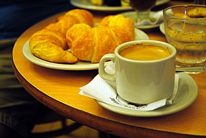 Merienda - Traditional serving of merienda in Café El Gato Negro, Buenos Aires. Medialunas (croissants), café en jarrito (a double espresso coffee) and a little glass of sparkling water.