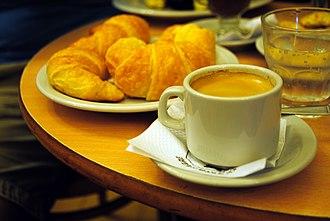 Merienda - Traditional serving of merienda in Café El Gato Negro, Buenos Aires. Medialunas (croissants), café en jarrito (a double espresso coffee) and a little glass of sparkling water.
