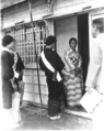 Members of Patriotic Women's Association visit family of enlisted men in Taichu, Formosa.png