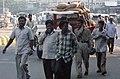 Men on the street (6676758821).jpg