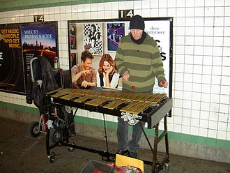 Vibraphone - Vibraphone busker.  The resonators have been removed, presumably to ease transportation.