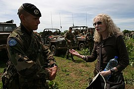 Mia Farrow in discussion with EUFOR soldier (2530868572).jpg