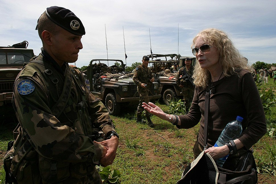 Mia Farrow in discussion with EUFOR soldier (2530868572)