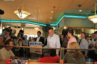Mitt Romney 2012 presidential campaign - Romney speaks with patrons at a Senate Coney Island Restaurant in Livonia, Michigan, during a campaign stop, June 9, 2011.