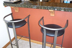 Bar stool - Modern bar stools in front of a kitchen counter