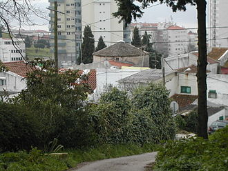 Ajuda - The remnants of the old windmill of Bairro do Caramão integrated into the newer buildings