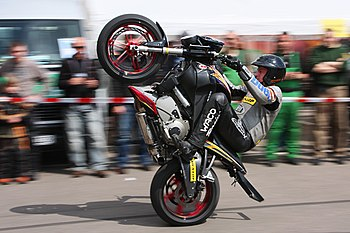 English: Motorcycle wheelie; driver: Rainer Sc...