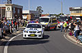 NSW Police, ASNSW and FRNSW vehicles in the SunRice Festival parade in Pine Ave.jpg