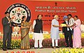 Narendra Modi distributing the first five Account Opening Kit to beneficiaries of the 'Pradhan Mantri Jan Dhan Yojana (PMJDY)', in New Delhi. The Union Minister for Finance, Corporate Affairs and Defence.jpg