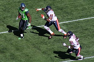 Lance Briggs - Briggs (upper right) and Charles Tillman pursue Seattle Seahawks receiver Nate Burleson in a game in 2009.