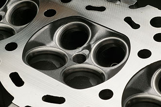 Multi-valve - A cylinder head of a four valve engine. ( Nissan VQ engine )