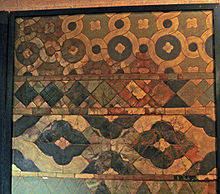 An array of tiles of differing shapes and colours