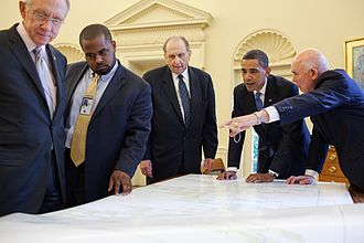 Thomas S. Monson - Monson, accompanied by apostle Dallin H. Oaks and Senate Majority Leader Harry Reid, delivers family history records to U.S. President Barack Obama