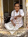 Old Woman in Window - Trinidad - Cuba.jpg
