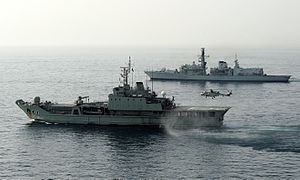 Royal Navy of Oman - The amphibious support vessel RNOV Nasr al Bahr (nearest) on an exercise with a UK warship (HMS Monmouth)