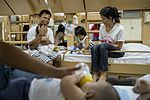 Operation Smile patients board USNS Mercy during Pacific Partnership 2015 150808-F-YW474-219.jpg