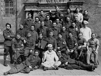 Oflag IV-C - A group of the French orderlies from Colditz Castle poses for a picture in the inner courtyard.