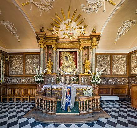 The interior of the Chapel of the Gate of Dawn with the holy Our Lady of the Gate of Dawn painting Our Lady of the Gate of Dawn Interior During Service, Vilnius, Lithuania - Diliff.jpg