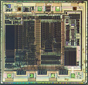 PIC microcontroller - Die of a PIC12C508 8-bit, fully static, EEPROM/EPROM/ROM-based CMOS microcontroller manufactured by Microchip Technology using a 1200 nanometre process