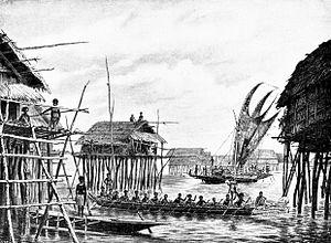 Lakatoi - Papuan lake dwellings with a lakatoi under sail, 1898 or before.