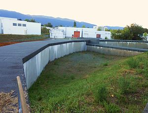 Proton Synchrotron Booster - The surface above the PS Booster at CERN. The ring-shaped accelerator is visible as a circular building that rises from the ground.