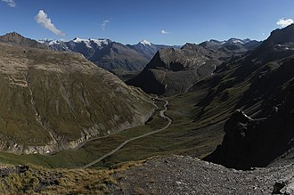 At an altitude of 2,770 m (9,090 ft), the summit of the Col de l'Iseran mountain pass (viewed southwards from the summit) on stage 19 is the highest paved pass in the Alps. Panoramic view near the Col de l'Iseran (21266894806) (cropped).jpg