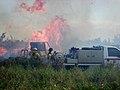 PelicanIsland NWR Crew Monitors pile burn Schardt (5202239178).jpg