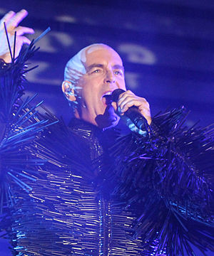 Neil Tennant - Tennant singing in a Pet Shop Boys concert at the 2013 Berlin Festival