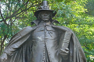 "The Pilgrim by Augustus St. Gaudens, 1904. The ""buckle hat"" atop the sculpture's head, now associated with the Pilgrims in pop culture, was fictional; Pilgrims never wore such an item, nor has any such hat ever existed as a serious piece of apparel. Pilgrim Fairmount 2.jpg"