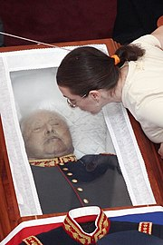 Pinochet inside his coffin at the time of the funeral.