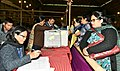 Polling officials collecting the Electronic Voting Machines (EVMs) and other necessary belongings for use in the Meghalaya Assembly Election, at Shillong on February 26, 2018.jpg