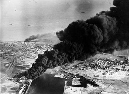 Smoke rises from oil tanks beside the Suez Canal hit during the initial Anglo-French assault on Port Said, 5 November 1956. Port Said from air.jpg