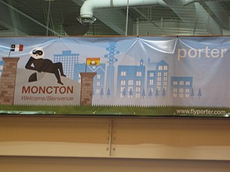 Greater Moncton Roméo LeBlanc International Airport - A Porter Airlines banner inside the terminal