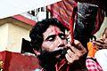 Praying lord Siva at Ambubasi Mela.jpg