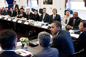 White House Initiative on Asian Americans and Pacific Islanders - President Barack Obama drops by an Interagency Working Group meeting in the Eisenhower Executive Office Building in March 2011.