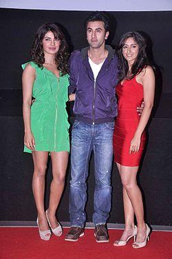 A photograph of Priyanka Chopra, Ranbir Kapoor and Ileana D'Cruz looking forward, smiling and posing for the camera