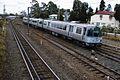 QR EMU unit 07 in original colour scheme on a Beenleigh bound train at Rocklea, ~1987.jpg
